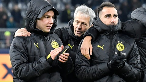 <p>               Dortmund's head coach Lucien Favre, center, talks to substitute players Mario Goetze, left, and Paco Alcacer, right, after winning the Champions League Group F soccer match between Borussia Dortmund and Slavia Praha in Dortmund, Germany, Tuesday, Dec. 10, 2019. Borussia defeated Slavia with 2-1. (AP Photo/Martin Meissner)             </p>
