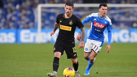 <p>               Inter's Stefano Sensi, left, and Napoli's Hirving Lozano battle for the ball during the Serie A soccer match between Napoli and Inter Milan at the San Paolo stadium Naples, Italy, Monday Jan. 6, 2020. (Cafaro/LaPresse via AP)             </p>
