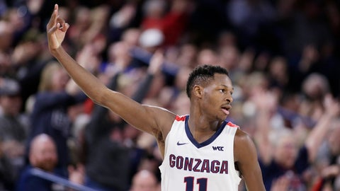 <p>               Gonzaga guard Joel Ayayi (11) gestures after scoring a 3-pointer during the second half of the team's NCAA college basketball game against Pepperdine in Spokane, Wash., Saturday, Jan. 4, 2020. Gonzaga won 75-70. (AP Photo/Young Kwak)             </p>