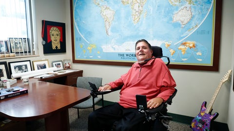 <p>               In this Wednesday, Jan. 22, 2020 photo, Marc Buoniconti, who was paralyzed from the shoulders down making a tackle in college in 1985, poses for a portrait in his office at the The Miami Project to Cure Paralysis in Miami. As the Super Bowl returns to Miami this week, Marc has mixed feelings about the sport. (AP Photo/Brynn Anderson)             </p>