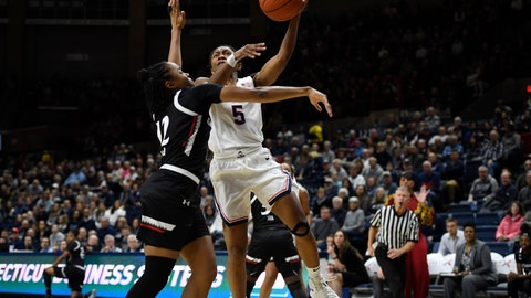 <p>               Connecticut's Crystal Dangerfield, right, shoots over Cincinnati's Antoinette Miller in the first half of an NCAA college basketball game, Thursday, Jan. 30, 2020, in Storrs, Conn. (AP Photo/Jessica Hill)             </p>