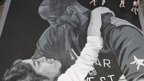 <p>               Students walk beside a giant mural of former NBA basketball player Kobe Bryant and daughter Gianna at a basketball court in Taguig, south of Manila, Philippines on Tuesday, Jan. 28, 2020. Artists in this tenement building gathered and painted this image after learning of Bryant's death. Bryant, his daughter and 7 others died in a helicopter crash. (AP Photo/Aaron Favila)             </p>