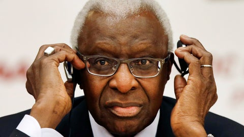 <p>               FILE - In this Aug. 21, 2015, file photo, then-IAAF president Lamine Diack adjusts his headphones during a joint IOC and IAAF news conference on the site of the World Athletic Championships in Beijing. One of the biggest sports corruption cases to reach court is being heard in Paris. The trial will hear allegations that Russian athletes paid millions of dollars to cover up their suspected doping in order to compete at the Olympic Games in 2012 and other competitions. Accused recipients of the payments include Lamine Diack, who presided for nearly 16 years at track and field's governing body. (AP Photo/Kin Cheung, File)             </p>