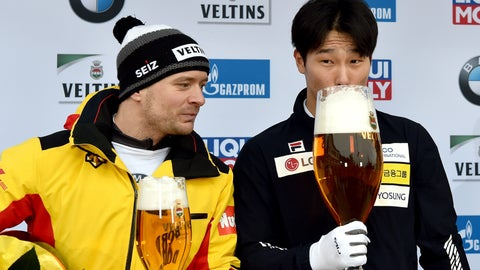 <p>               Yun Sung Bin from South Korea zips from a giant glass of beer after winning the men's Skeleton world cup in Winterberg, Germany, Sunday, Jan.5, 2019.  Germany's Axel Jungk at left.(Caroline Seidel/dpa via AP)             </p>