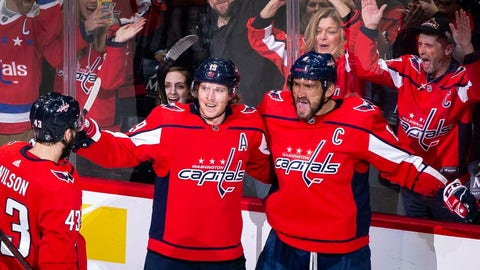 <p>               Washington Capitals left wing Alex Ovechkin (8), from Russia, celebrates after scoring as right wing Tom Wilson (43), from Canada, and Nicklas Backstrom (19), from Sweden, join during the first period of an NHL hockey game against the Carolina Hurricanes, Monday, Jan. 13, 2020, in Washington. (AP Photo/Al Drago)             </p>