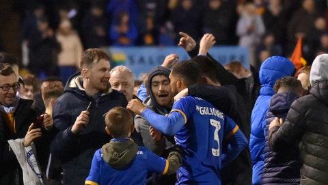<p>               Shrewsbury's Scott Goldbourne, center, celebrates with fans at the end of the English FA Cup fourth round soccer match between Shrewsbury Town and Liverpool at the Montgomery Waters Meadow in Shrewsbury, England, Sunday, Jan. 26, 2020. (AP Photo/Rui Vieira)             </p>