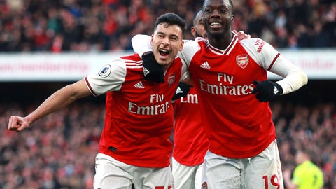<p>               Arsenal's Gabriel Martinelli, left, celebrates scoring his sides first goal of the game with teammate Nicolas Pepe during the English Premier League soccer match between Arsenal and Sheffield United at the Emirates Stadium, London, Saturday, Jan. 18, 2020. (Adam Davy/PA via AP)             </p>