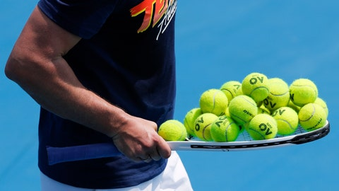 <p>               A coach carries a racket loaded with balls during a practice session ahead of the Australian Open tennis championship in Melbourne, Australia, Sunday, Jan. 19, 2020. (AP Photo/Andy Wong)             </p>