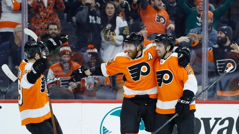<p>               Philadelphia Flyers' Jakub Voracek, center, celebrates with Matt Niskanen, right, and Joel Farabee after scoring a goal during the second period of an NHL hockey game against the Pittsburgh Penguins, Tuesday, Jan. 21, 2020, in Philadelphia. (AP Photo/Matt Slocum)             </p>