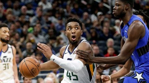 <p>               Utah Jazz guard Donovan Mitchell (45) drives around Orlando Magic center Mo Bamba during the second half of an NBA basketball game, Saturday, Jan. 4, 2020, in Orlando, Fla. (AP Photo/John Raoux)             </p>