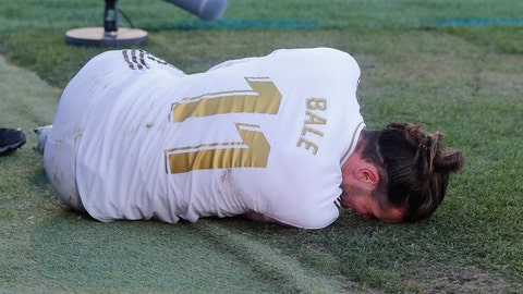 <p>               Real Madrid's Gareth Bale lies on the pitch after a tackle during a Spanish La Liga soccer match between Getafe and Real Madrid at the Coliseum Alfonso Perez stadium in Getafe, Spain, Saturday, Jan. 4, 2020. (AP Photo/Paul White)             </p>