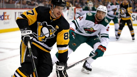 <p>               Pittsburgh Penguins' Sidney Crosby (87) works the puck in the corner with Minnesota Wild's Matt Dumba (24) defending during the second period of an NHL hockey game in Pittsburgh, Tuesday, Jan. 14, 2020. (AP Photo/Gene J. Puskar)             </p>