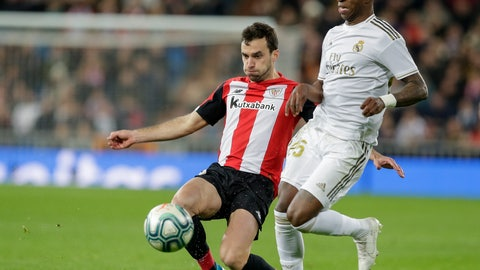 <p>               Real Madrid's Vinicius Junior, front, is tackled by Athletic Bilbao's Inigo Lekue during a Spanish La Liga soccer match between Real Madrid and Athletic Bilbao at the Santiago Bernabeu stadium in Madrid, Spain, Sunday Dec. 22, 2019. (AP Photo/Paul White)             </p>
