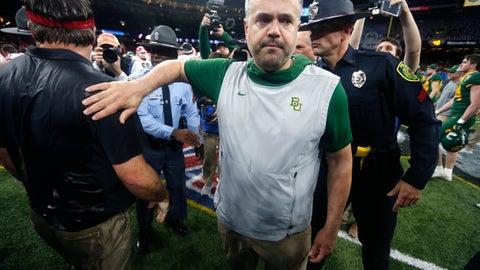<p>               Baylor head coach Matt Rhule walks away after greeting Georgia head coach Kirby Smart after the Sugar Bowl NCAA college football game in New Orleans, Wednesday, Jan. 1, 2020. Georgia won 26-14. (AP Photo/Brett Duke)             </p>