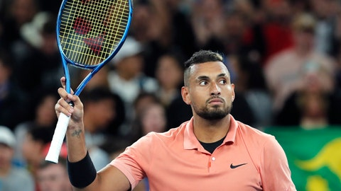 <p>               Australia's Nick Kyrgios waves after defeating Italy's Lorenzo Sonego in their first round singles match at the Australian Open tennis championship in Melbourne, Australia, Tuesday, Jan. 21, 2020. (AP Photo/Andy Brownbill)             </p>