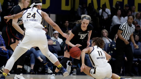<p>               Stanford's Lexie Hull, center, controls the ball between California's Evelien Lutje Schipholt (24) and Sara Anastasieska (11) in the first half of an NCAA college basketball game Sunday, Jan. 12, 2020, in Berkeley, Calif. (AP Photo/Ben Margot)             </p>
