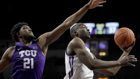 <p>               Kansas State forward Makol Mawien, right, drives past TCU center Kevin Samuel (21) during the second half of an NCAA college basketball game in Manhattan, Kan., Tuesday, Jan. 7, 2020. (AP Photo/Orlin Wagner)             </p>