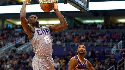 <p>               Charlotte Hornets center Bismack Biyombo dunks over Phoenix Suns forward Mikal Bridges (25) during the first half of an NBA basketball game Sunday, Jan. 12, 2020, in Phoenix. (AP Photo/Rick Scuteri)             </p>