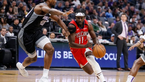 <p>               New Orleans Pelicans guard Jrue Holiday, right, drives against Sacramento Kings forward Harrison Barnes during the first quarter of an NBA basketball game in Sacramento, Calif., Saturday, Jan. 4, 2020. (AP Photo/Rich Pedroncelli)             </p>