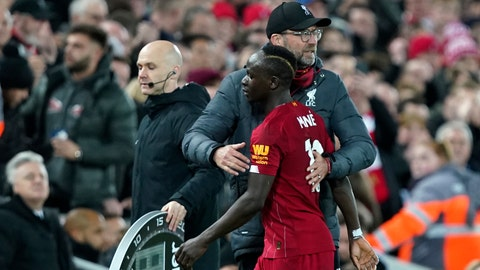 <p>               Liverpool's manager Jurgen Klopp embraces Liverpool's Sadio Mane during the English Premier League soccer match between Liverpool and Sheffield United at Anfield Stadium, Liverpool, England, Thursday, Jan. 2, 2020. (AP Photo/Jon Super)             </p>