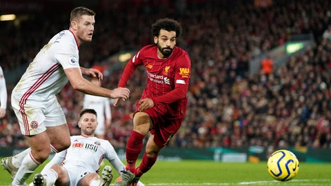 <p>               Sheffield United's Jack O'Connell, left, and Liverpool's Mohamed Salah run for the ball during the English Premier League soccer match between Liverpool and Sheffield United at Anfield Stadium, Liverpool, England, Thursday, Jan. 2, 2020. (AP Photo/Jon Super)             </p>