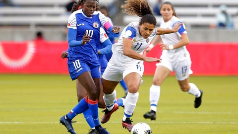<p>               Costa Rica forward Raquel Rodriguez (11) falls while chasing the ball as she is pushed from behind by Haiti forward Nerilia Mondesir (10) during the first half of a CONCACAF women's Olympic qualifying soccer match Friday, Jan. 31, 2020, in Houston. (AP Photo/Michael Wyke)             </p>