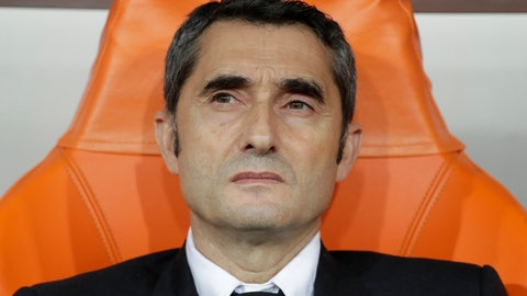 <p>               Barcelona's head coach Ernesto Valverde sits on the bench prior the Spanish Super Cup semifinal soccer match between Barcelona and Atletico Madrid at King Abdullah stadium in Jiddah, Saudi Arabia, Thursday, Jan. 9, 2020. (AP Photo/Hassan Ammar)             </p>