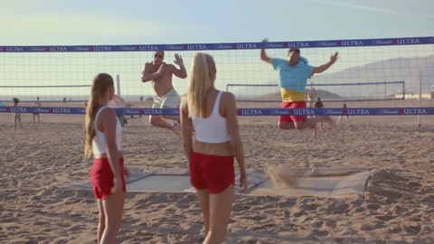<p>               This undated image provided by Michelob ULTRA shows from left, Brooke Sweat, John Cena, Kerri Walsh Jennings and Jimmy Fallon in a scene from the company's 2020 Super Bowl NFL football spot.  Michelob Ultra stresses its low calories and low carbs in an ad that shows talk show host Jimmy Fallon and wrestler John Cena working out. (Michelob ULTRA via AP)             </p>