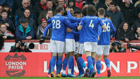 <p>               Leicester's players celebrate their side's first goal, scored by Kelechi Iheanacho, during the English FA Cup fourth round soccer match between Brentford FC and Leicester City at Griffin Park stadium in London, Saturday, Jan. 25, 2020. (AP Photo/Kirsty Wigglesworth)             </p>