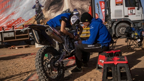 "<p>               In this Monday, Jan. 13, 2020 photo, Sara Garcia of Spain checks her Yamaha motorbike, next to his partner Javier Vega of Spain at the Dakar rally ""park ferme"" in Wadi Al Dawasir, Saudi Arabia. Formerly known as the Paris-Dakar Rally, the race was created by Thierry Sabine after he got lost in the Libyan desert in 1977. Until 2008, the rallies raced across Africa, but threats in Mauritania led organizers to cancel that year's event and move it to South America. It has now shifted to Saudi Arabia. The race started on Jan. 5 with 560 drivers and co-drivers, some on motorbikes, others in cars or in trucks. Only 41 are taking part in the Original category. (AP Photo/Bernat Armangue)             </p>"
