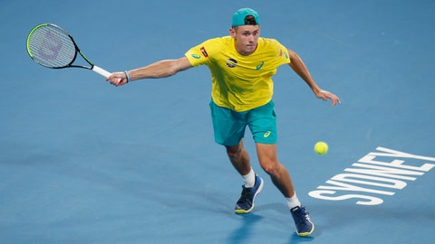 <p>               FILE - In this Jan. 11, 2020, file photo, Alex de Minaur of Australia plays a shot against Rafael Nadal of Spain during their ATP Cup tennis match in Sydney. Top-seeded Alex de Minaur was forced out of the Adelaide International Monday, Jan. 13, 2020 with an abdominal strain. (AP Photo/Steve Christo, File)             </p>