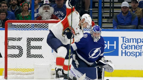 <p>               Florida Panthers center Aleksander Barkov (16) works for the puck in front of Tampa Bay Lightning goaltender Andrei Vasilevskiy (88) during the second period of an NHL hockey game Monday, Dec. 23, 2019, in Tampa, Fla. (AP Photo/Chris O'Meara)             </p>