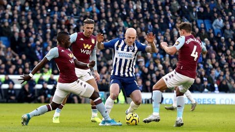 <p>               Brighton and Hove Albion's Aaron Mooy up against Aston Villa's Marvelous Nakamba, left, Jack Grealish and Danny Drinkwater, right, during the English Premier League soccer match between Brighton and Hove Albion and Aston Villa at the AMEX stadium, Brighton, England. Saturday, Jan. 18, 2020.(Gareth Fuller/PA via AP)             </p>