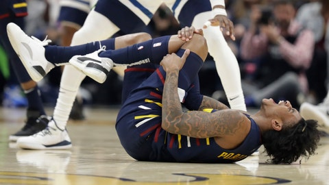 <p>               Cleveland Cavaliers' Kevin Porter Jr. holds his knee after an injury in the second half of an NBA basketball game against the Minnesota Timberwolves, Sunday, Jan. 5, 2020, in Cleveland. Porter left the game due to the injury. Minnesota won 118-103. (AP Photo/Tony Dejak)             </p>