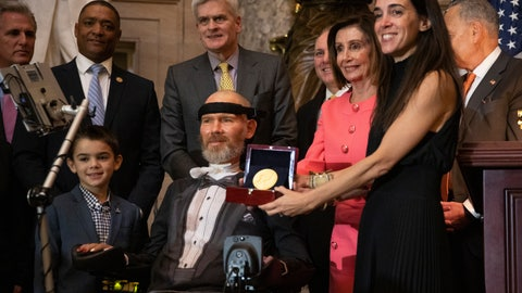 <p>               A Congressional Gold Medal is presented to amyotrophic lateral sclerosis (ALS) advocate and former National Football League (NFL) player, Steve Gleason, in Statuary Hall on Capitol Hill, Wednesday, Jan. 15, 2020, in Washington. Holding the medal is his wife Michel Gleason. (AP Photo/Manuel Balce Ceneta)             </p>