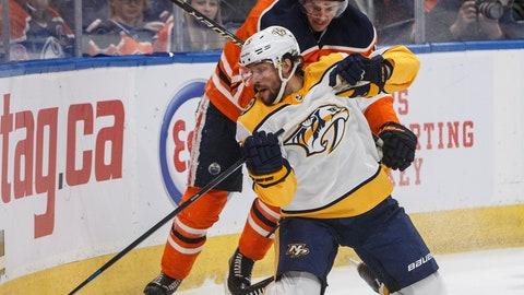 <p>               Nashville Predators' Craig Smith (15) and Edmonton Oilers' Josh Archibald (15) battle for the puck during first period NHL hockey action in Edmonton, Alberta, Tuesday, Jan. 14, 2019. (Jason Franson/The Canadian Press via AP)             </p>