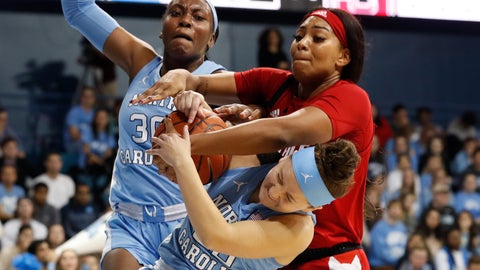 <p>               North Carolina guard Leah Church, bottom and center Janelle Bailey (30) struggle for a rebound with North Carolina State center Erika Cassell during the first half of an NCAA college basketball game in Chapel Hill, N.C., Thursday, Jan. 9, 2020. (AP Photo/Gerry Broome)             </p>