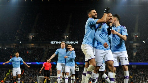 <p>               Manchester City's Gabriel Jesus, second right, celebrates with teammates after scoring his side's opening goal during the English Premier League soccer match between Manchester City and Everton at Etihad stadium in Manchester, England, Wednesday, Jan. 1, 2020. (AP Photo/Rui Vieira)             </p>