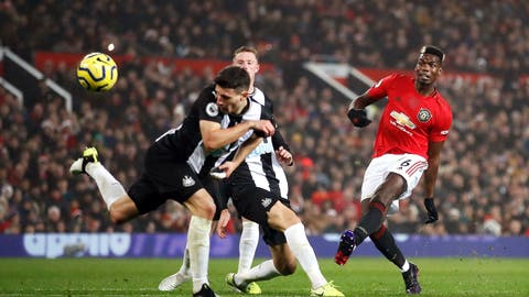 <p>               Manchester United's Paul Pogba shoots at goal during their English Premier League soccer match against Newcastle United at Old Trafford, Manchester, England, Thursday, Dec. 26, 2019. (Martin Rickett/PA via AP)             </p>