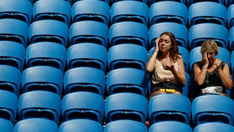 <p>               Fans apply sunscreen as they wait for a match in their third round match between Argentina's Diego Schwartzman and Serbia's Dusan Lajovic at the Australian Open tennis championship in Melbourne, Australia, Friday, Jan. 24, 2020. (AP Photo/Andy Wong)             </p>