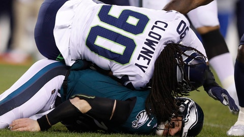 <p>               Philadelphia Eagles' Carson Wentz (11) is hit by Seattle Seahawks' Jadeveon Clowney (90) during the first half of an NFL wild-card playoff football game, Sunday, Jan. 5, 2020, in Philadelphia. (AP Photo/Julio Cortez)             </p>