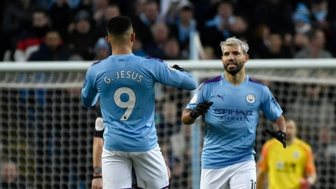 <p>               Manchester City's Sergio Aguero, right, celebrates with Manchester City's Gabriel Jesus after scoring his side's opening goal during the English Premier League soccer match between Manchester City and Crystal Palace at Etihad stadium in Manchester, England, Saturday, Jan. 18, 2020. (AP Photo/Rui Vieira)             </p>