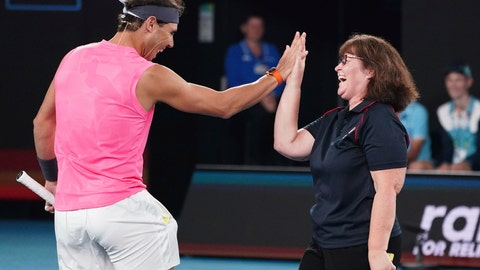<p>               Rafael Nadal of Spain, left, and Deb Boirg, an Australian firefighter celebrate as they play a game of tennis together during the Rally For Relief at Rod Laver Arena in Melbourne, Wednesday, Jan. 15, 2020. Tennis stars have come together for the Rally for Relief to raise money in aid of the bushfire relief efforts across Australia. (Scott Barbour/AAP Image via AP)             </p>