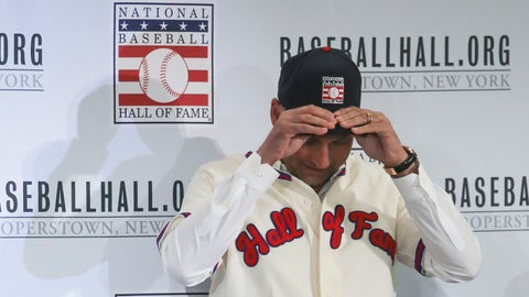 <p>               New York Yankees shortstop Derek Jeter fits his cap after receiving his outfit for the Baseball Hall of Fame, Wednesday Jan. 22, 2020, during a news conference in New York. Jeter and Colorado Rockies outfielder Larry Walker will both join the 2020 Hall of Fame class. (AP Photo/Bebeto Matthews)             </p>