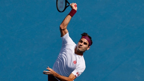 <p>               Switzerland's Roger Federer makes a forehand return to Tennys Sandgren of the U.S. during their quarterfinal match at the Australian Open tennis championship in Melbourne, Australia, Tuesday, Jan. 28, 2020. (AP Photo/Andy Wong)             </p>