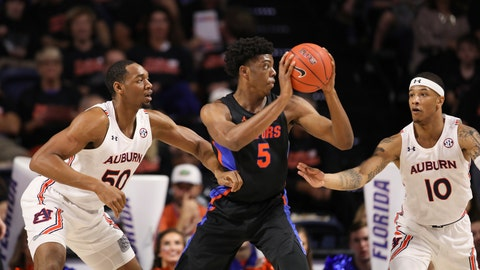 <p>               Florida forward Omar Payne (5) spins between Auburn center Austin Wiley (50) and guard Samir Doughty (10) during the first half of an NCAA college basketball game Saturday, Jan. 18, 2020, in Gainesville, Fla. (AP Photo/Matt Stamey)             </p>