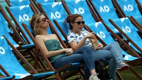 <p>               Spectators wait for play to start in Garden Square ahead of the first round singles matches at the Australian Open tennis championship in Melbourne, Australia, Monday, Jan. 20, 2020. (AP Photo/Dita Alangkara)             </p>
