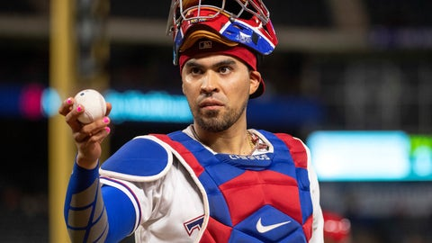 <p>               FILE - In this Aug. 16, 2018, file photo, Texas Rangers catcher Robinson Chirinos offers to toss a ball to a fan during a baseball game against the Los Angeles Angels, in Arlington, Texas. Robinson Chirinos and the Texas Rangers were close Wednesday, Jan. 8, 2020, to a $6.5 million, one-year contract to reunite after the veteran catcher spent a season with the AL West rival Houston Astros. A person familiar with the deal said the agreement was contingent on a successful physical. The person spoke to The Associated Press on condition of anonymity because there had been no official announcement. (AP Photo/Jeffrey McWhorter, File)             </p>