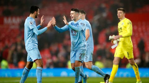 <p>               Burnley's Dwight McNeil, left, and Matthew Lowton celebrate at the end of the Premier League match at Old Trafford, Manchester Wednesday January 22, 2020.   (Martin Rickett/PA via AP)             </p>