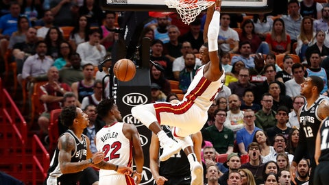 <p>               Miami Heat center Bam Adebayo (13) dunks the ball against the San Antonio Spurs in the first half of an NBA basketball game Wednesday, Jan. 15, 2020, in Miami. (AP Photo/Brynn Anderson)             </p>